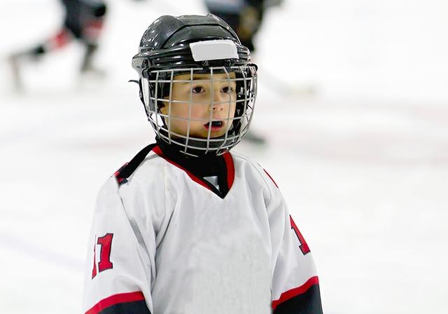 Kid playing ice hockey