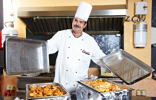 chef with food at restaurant