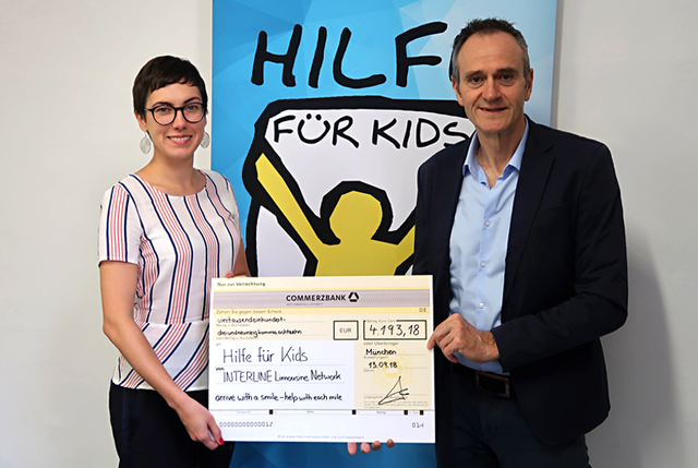 INTERLINE_Hilfe-für-Kids_Scheckübergabe__bearbeitet.png