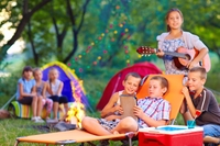 group of happy kids on summer picnic